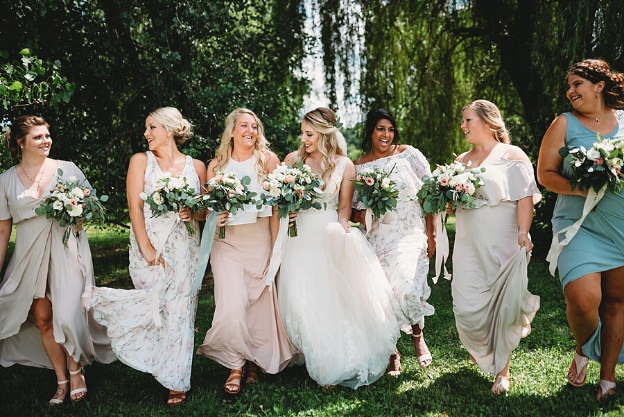Group of bridesmaids walking in Sow Me Your Mumu bridesmaid dresses at a wedding in Wisconsin Dells at the Wilderness Resort wedding venue
